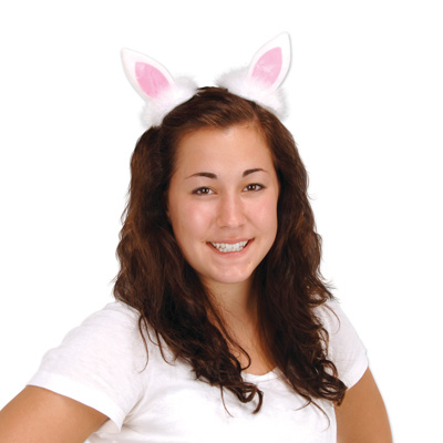 Plush bunny ears on a metal hair clip and faux material.