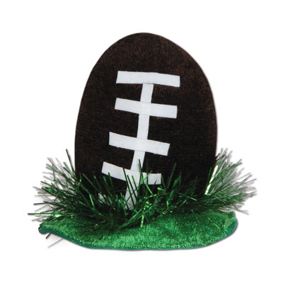 Football laying in grass Hair Clip