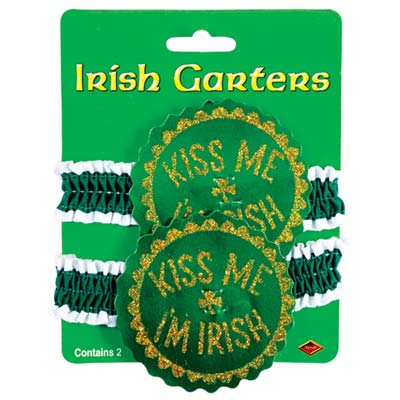 "Green garters with white boarder and fabric medallion glittered saying of ""Kiss Me Im Irish""."