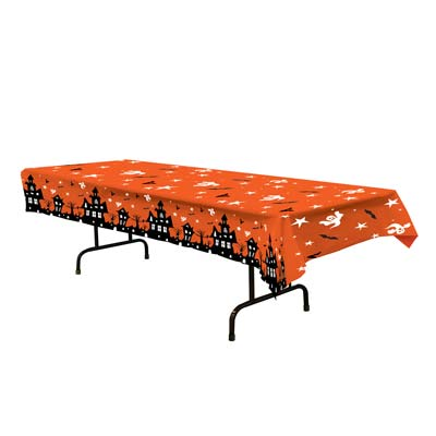 Halloween table over with haunted houses and ghosts on an orange background