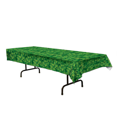 plastic table cover with green shamrocks printed on it