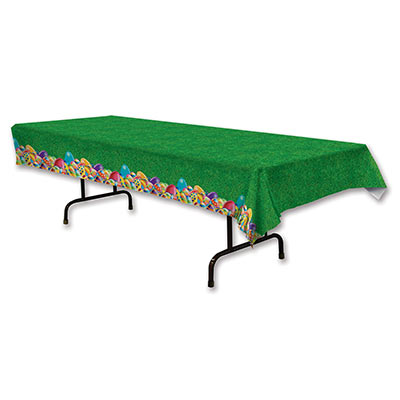plastic table cover for Easter that looks like grass on the top and colored Easter eggs along the sides