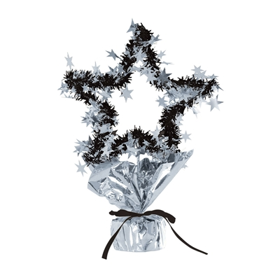 Metallic silver and black wired table centerpiece molded into the shape of a star and wrapped in black fringe and silver star embelishments.