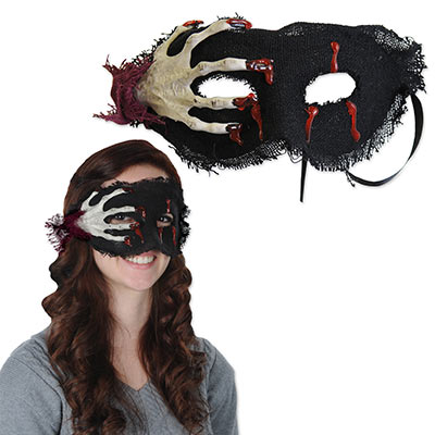 Halloween mask with a scary hand grasping at the wearers face