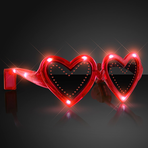 Heart Shaped Red Light Up Novelty Sunglasses. These Heart Shaped Light up sunglasses are perfect for glow in the dark parties.