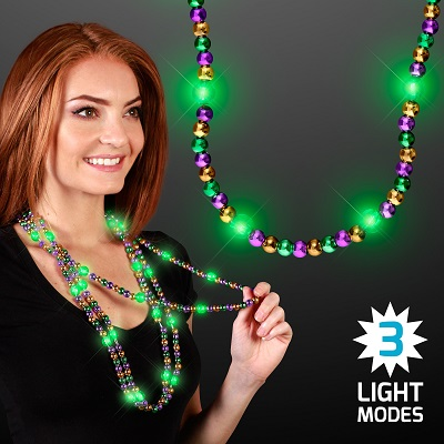 Light Up Beads Mardi Gras Necklace with three light modes. These light up necklaces are the perfect addition to your mardi gras party outfit.