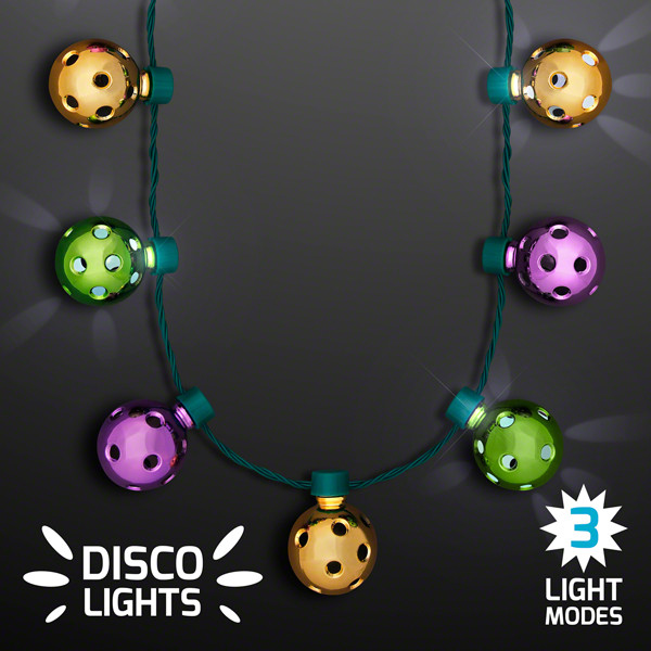 Necklace with gold, green and purple disco balls that lights up.