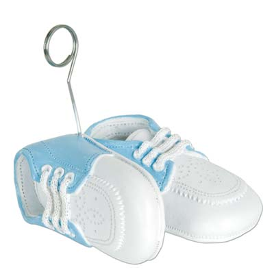 Balloon weights of blue baby shoes with metal balloon holder.