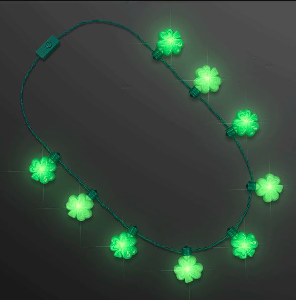 Necklace with shamrocks attached that lights up with LED lights.