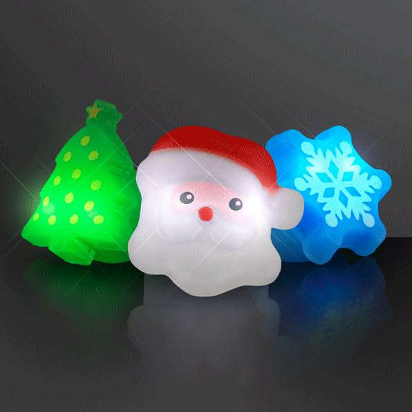 Christmas rings that lights up in shapes of a Christmas tree, Santa and a snowflake.