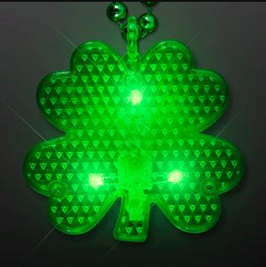 Flashing LED Shamrock Charm. This Flashing Shamrock Charm is the perfect addition to any St. Patricks Day outfit.