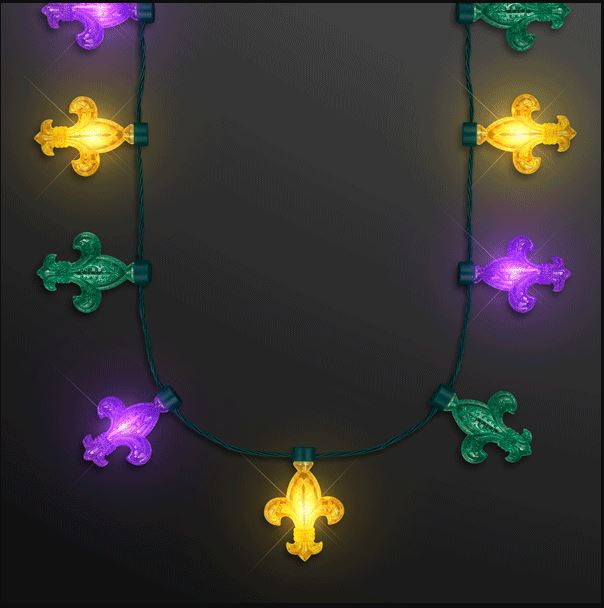 Necklace with green, yellow and purple Fleur de Lis designs that lights up.