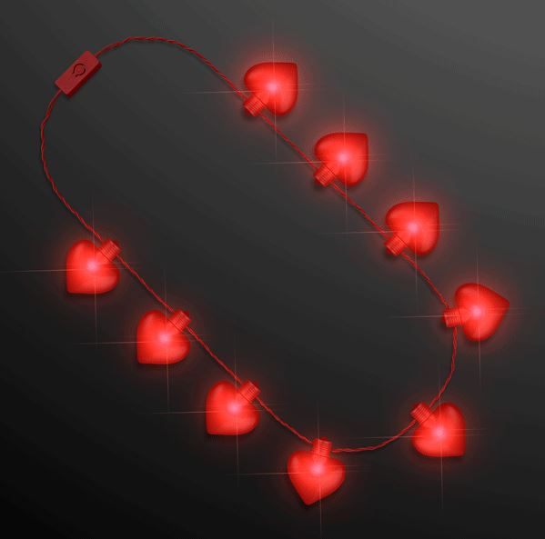 Necklace with hearts attached and lights up with LED lights.